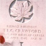 Gravemarker– This photo of Rfn Crawford's grave at Holten Cemetery in Holland was taken by his daughter Joan Crawford - Barrer in May, 2001.