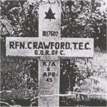 Gravemarker - photo 3– This is a photo of the temporary wooden marker on Rfn Crawford's grave at Holten Cemetery in the post-war period prior to the granite headstones being erected.