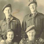 Family photo– John Harrison standing on right with brothers Pat and Del and sister-in-law Betty. Photo taken in England in Spring of 1945.