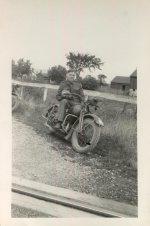 Photo of Wilbert Charles John Hobbs– Bert Hobbs overseas on his motorcycle