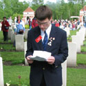 Photo of Adnan Saciragic– Adnan Saciragic, Youth Delegate from Prince Edward Island (PEI), gives a commemorative presentation on the life of John Archibald MacLaren of Goose River, PEI, on May 5, 2005, in front of his grave at Holten Canadian War Cemetery in the Netherlands.
