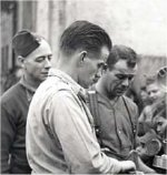 Photo of John Scott– Italian civilians suffered from injuries caused by mines, shells and stray bullets. Many lost their homes and crops. Here gunners Chink Gades and Johnny Scott, 11th Field Regiment, serving corned beef to children in Acireale, December 13th, 1943.