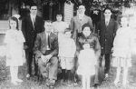 Family Memorial– Henry and Matilda Meloche Family, circa 1913; Harold is the boy standing between his father and mother.