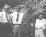 Family photo– Alcide, Sam, Leo, and Rose Deschamps on a trip to Montreal, Quebec on Leo's last leave in Canada.  Sam served with the U.S. Navy.