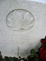 Grave Marker– The grave marker at the Dieppe Canadian War Cemetery located approximately 5 km. from the beach of Dieppe, France. May he rest in peace. (K. Falconer & J. Stephens)