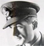 """Photo of George Desourdy– P.O. George Desourdy, RCAF, reported missing over North Sea May 26, 1942.   Photo courtesy of Hillcrest High School - """"Stairway of Honour"""" project.  Eighty-four large portraits of students from the Second World War line both sides of the 55 stairs leading up to the school's auditorium. Most of the portraits have the rank and year of death of the student. Some portraits explain how the soldier died, but many were MIA and presumed dead. Each year, teachers from the grade 10 Canadian History course take their students to the stairway around November 11th to complete a project that deals directly with the pictures on the Stairway of Honour."""