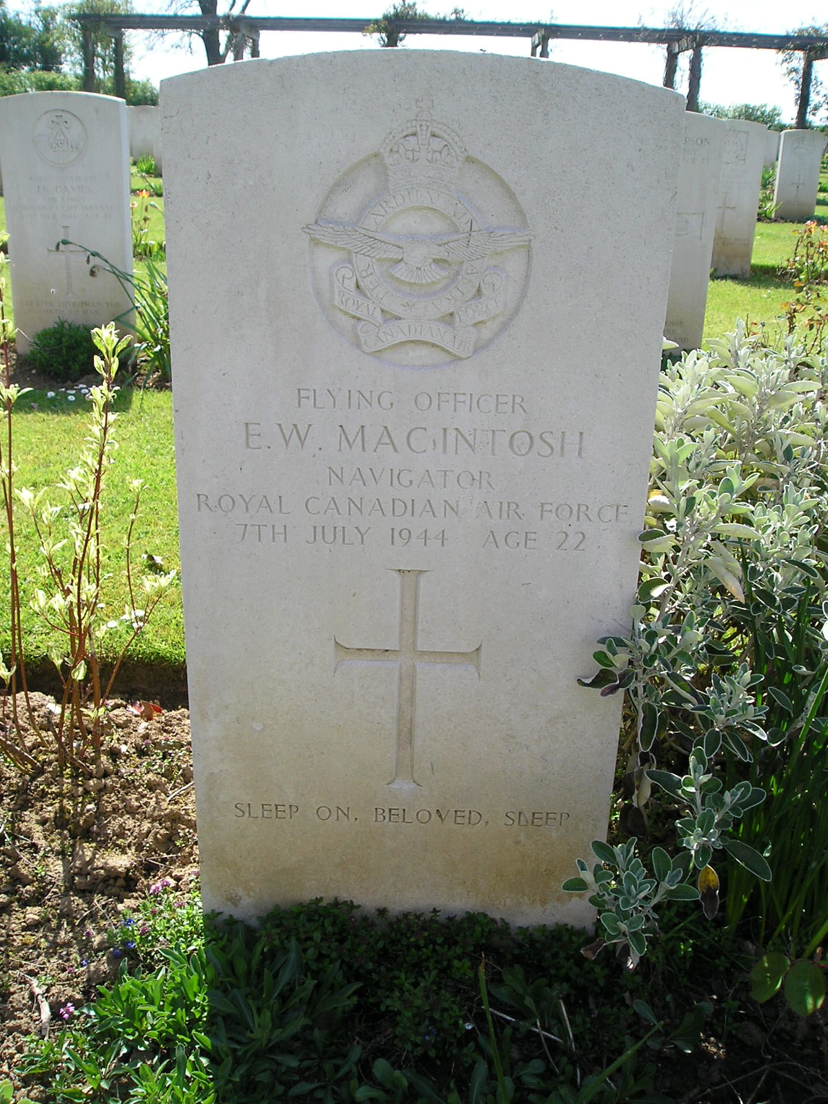 Grave Marker– Ernest William MacIntosh, from Trenton, Nova Scotia lies in Banneville-la-Campagne War Cemetery which is found on the D675 about 10 km east of Caen.