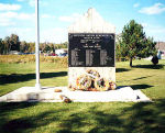 Memorial– A wooden wall, black marble plaque and metal flagpole at the corner of Ted Commanda Drive and Semo Road, Garden Village, ON was erected by members of the Nipissing First Nation. This memorial is dedicated to the band's war dead and veterans of the First and Second World Wars.  [plaque/plaque]  NIPISSING NATION REMEMBERS  KILLED IN ACTION  COMMANDA, MICHAEL JAMES, WWII GOULAIS, MICHAEL CLARENCE, DIED AT DIEPPE AUG 19, 1942 OBTAGESIC, GERALD, DIED APRIL 19, 1942 STEVENS, A., WWII WHITEDUCK, L.K., WWII