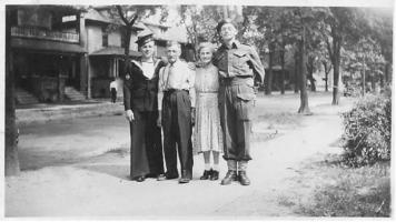 Group Photo– Photo of George Edward Gates (right) with his parents and brother Jim on Hall Street in Windsor, Ontario, Canada.  