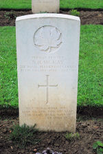 Grave Marker– A photograph of the headstone at the Bretteville-sur-Laize Canadian War Cemetery, located 20 kilometres south of Caen, France. May he rest in peace. (J. Stephens)