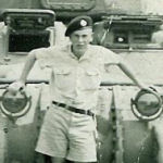 Photo of WILLIAM MACLEOD– William in front of tank. France, July 1944.