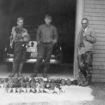 Brian Lynn and his friend Vernon Harding– Picture taken in the fall of 1938 in St. Pacome, Ouebec. Depicted are my father Vernon Harding (holding puppy) Brian Lynn (in the middle) and my grandfather Harold Harding. Both boys are 15 at the time and were schoolmates attending Bishops College Prep School in Lennoxville, Quebec. My grandfather and Brian's father were acquainted and were both keen duck hunters, something they passed on to their sons. The birds were taken along the south shore of the St Lawrence near Kamouraska, Quebec. My father named my elder brother Brian in memory of his friend, and my brothers and I still enjoy duck hunting, although it has been many years since we tried our luck in Kamouraska.
