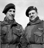 Group Photo– Lieutenants Joseph Philippe Rousseau (left) and Joseph Maurice Rousseau, 1st Canadian Parachute Battalion, at a transit camp near Down Ampney, England, 13 February 1944. Both officers were later killed in action, Philippe on 7 June 1944 and Maurice on 20 September 1944.