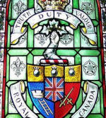Memorial Stained Glass– Lieutenant Joseph Philippe Rousseau served with the 1st Canadian Parachute Battalion, R.C.I.C. He is remembered as cadet # 2803 (1940) at the Royal Military College of Canada on the WWII Memorial, in stained glass windows, and on the Memorial stairwell.
