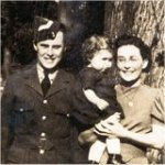 Photo 3 of Kimble Calvin Sanderson– Kimble Calvin Sanderson posing with his sister, Lilian Wood and her daughter, Ruth Wood. This photo was taken in Belleville, Ontario in the fall of 1942.