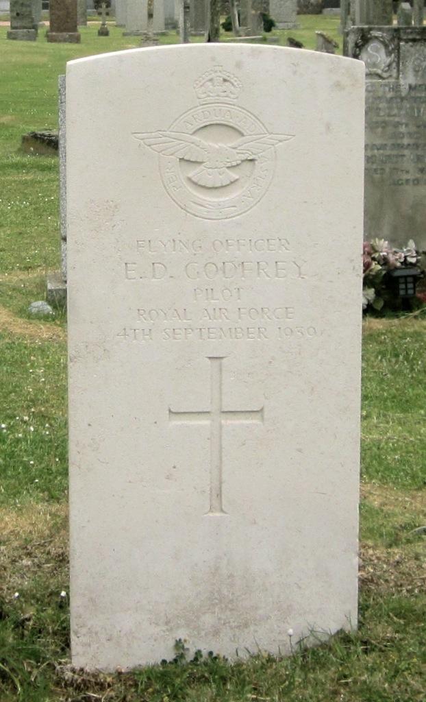 Grave marker– [Royal Air Force Crest]  Flying Officer E.D. GODFREY PILOT ROYAL AIR FORCE 4TH SEPTEMBER 1939.