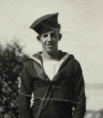 Photo of Raymond Clifford Dupuis– Raymond Clifford Dupuis at the Naval training base H.M.C.S Cornwallis in Nova Scotia. He is posing with the mascot who is resting his head on the life ring.