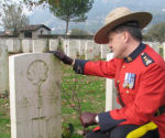 Paying respects– Superintendent Greg Peters of the RCMP at the Gravesite of Laurence Kenneth D'Albenas.