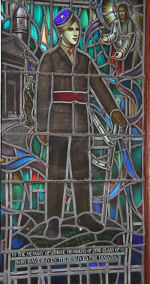 """Stained Glass Window– Lieutenant Joseph McBride was the son of C. A. and Thomasine McBride, of Barrie, Ontario. He entered Royal Military College, Kingston, in the spring of 1940 and graduated in June 1942.  He wrote several poems, one of these being titled """"When the Winds Blew', which was published in the Royal Military College Yearbook in 1942. He served with Governor General's Horse Guards, R.C.A.C. Division: `A' Sqn., 3rd Armd. Recce. Regt. He was wounded in action and died of wounds May 26, 1944. He was buried in the Cassino War Cemetery, Italy.  In Yeo Hall, at the Royal Military College of Canada there is a stained glass memorial window to the memory of those members of the class of 42 who have given their lives for Canada. The window was presented by the class of 1942."""