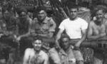 """Group Photo– Gunner, James """"Aloysius"""" Madore (In middle, white tee-shirt, standing behind barrel) and his mortar squad in taken in Italy 1944 on May 15, 1944 according to his own handwriting on the back of the photo. 2 days before he was KIA from friendly fire. Also indicates crew's first names only, except for a Sgt. Bill Boivin"""