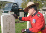 Paying respects– Superintendent Greg Peters of the RCMP at the Gravesite of John Francis Joseph Nelson.