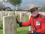 Paying respects– Superintendent Greg Peters of the RCMP at the grave of Donald Gilbert Stackhouse.