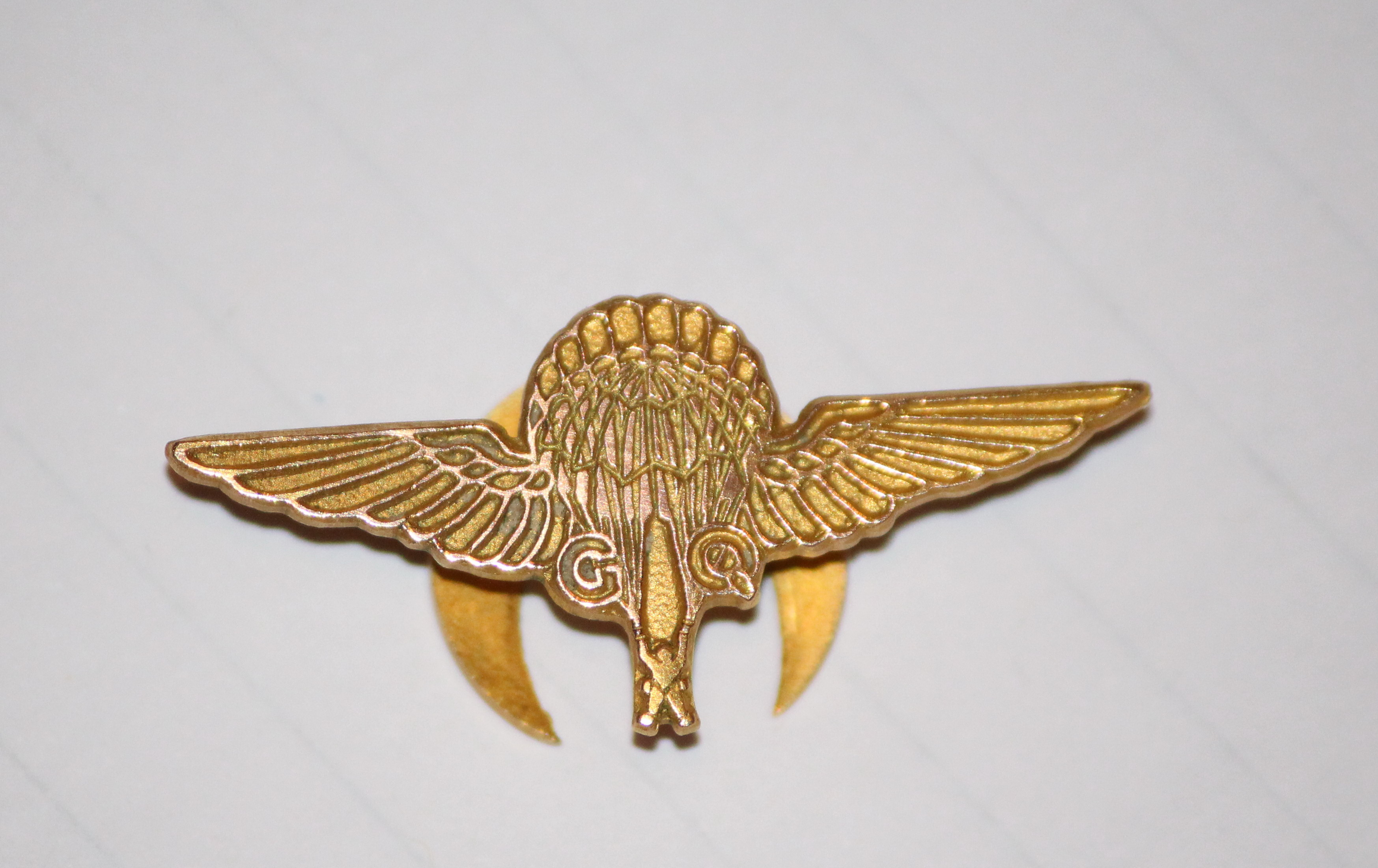 """Badge– Given to airmen in the War who had parachuted out of an airplane . Inscribed on back """"SAVED MY LIFE"""". and the RCAF airman's name and rank and date. Given to airmen who had bailed out by GQ Parachute Co. Ltd Woking."""