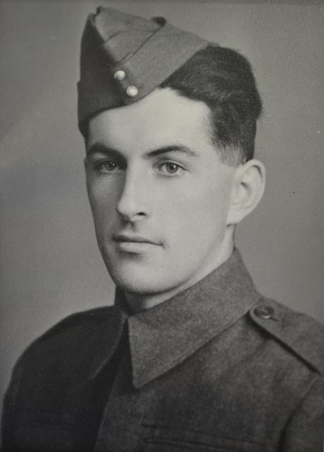 "Photo of Alfred Francis Clavelle– Photo of ALFRED FRANCIS CLAVELLE, Service Number L/65079, Gunner, Royal Canadian Artillery. Caption on back of photo: ""Alfred Francis Clavelle, Army picture. R. no. L65079. Joined army in 1940. Trained in Canada then sent to overseas spring of 1943. Was killed in action on June 6, 1944 Invasion of France. May he never be forgotten by loved ones."