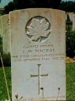 Gravestone of Earl W. MacRae– Gravesite of Private Earl W. MacRae from Tignish Shore, Prince Edward Island, son of Fred and Eva MacRae.  Died in action at 23 years of age, in Italy on September 17, 1944