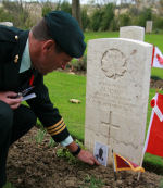 Paying respects– Lt. Gen.Stephen Molaski laying personal items on Metro's marker November 12, 2013 Coriano Ridge War Cemetery.  This was the first celebration by the Canadian Government Forces at Coriano Ridge.  