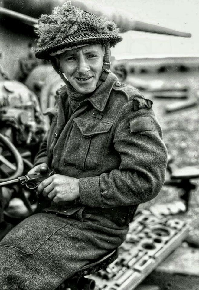 Photo of Earl McAllister– Corporal Earl McAllister (Hamilton, Ontario) of the Argyll and Sutherland Highlanders of Canada inspects a captured P08 Luger pistol on a knocked out German battery near Abbeville, France. Corporal McAllister is credited with having captured 160 prisoners at St. Lambert-sur-Dives.    Corporal McAllister was killed in Belgium on October 20th, 1944, and is buried in the Bergen op Zoom Canadian war cemetery in the Netherlands. — in ?Abbeville, France.