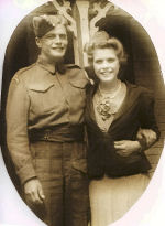 Group Photo– This is a picture of my Uncle Garfield and my mother, Dorothy Elizabeth Ina Stevenson, on their front porch,at Cookshire, Quebec, in 1940.