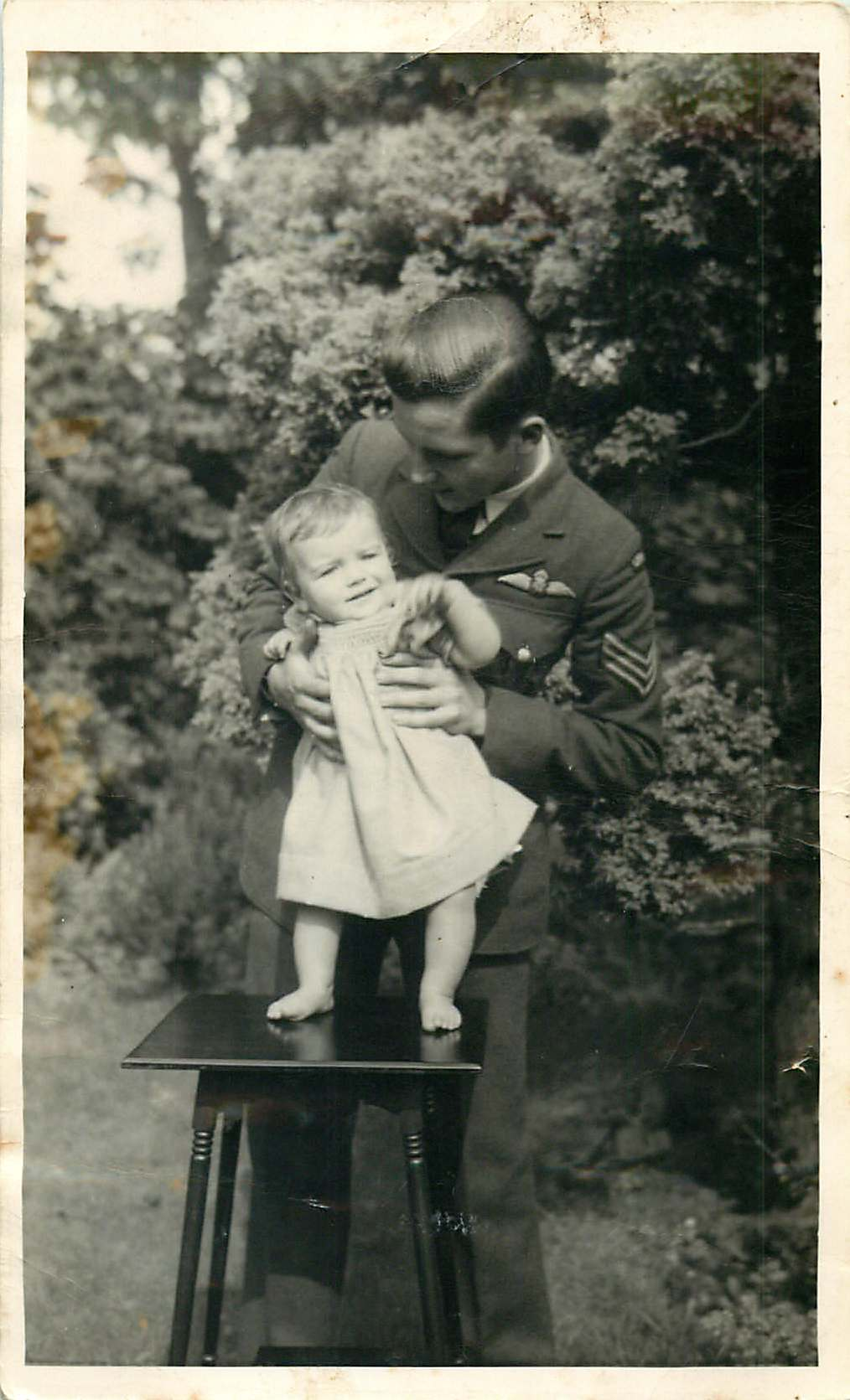 Group Photo– Robert M Buie my uncle holding me when I was 1 year old in 1942   Byron Alwyn Buie