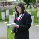 Photo of Amanda White– Mandy White, Youth Delegate from Yellowknife, Northwest Territories, gives a commemorative presentation on the life of Frederick Hutchinson Behie of Sheet Harbour, Nova Scotia, on May 5, 2005, in front of his grave at Groesbeek Canadian War Cemetery in the Netherlands.