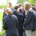 Photo 2 of Amanda White– Fellow Youth Delegates comfort Mandy White following her emotional presentation on the life of Frederick Hutchinson Behie.