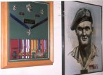 Medals– This photo was taken by Captain Craig Cameron in June 2000. The medals of Seregeant Cosens' and his portrait are on display at Moss Park Armoury, Toronto.  The Victoria Cross in the collection is a replica. The original VC is displayed at the Canadian Rifles Glenbow Museum in Calgary, Alberta.