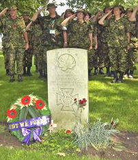 Salute– Members of the Canadian contingent salute while paying their respects at the grave of Victoria Cross winner, Sergeant Aubrey Cosens, who is buried at the Groesbeek Commonwealth cemetery in the Netherlands.  Department of National Defence photo: July 22, 2004, Nijmegen, the Netherlands.