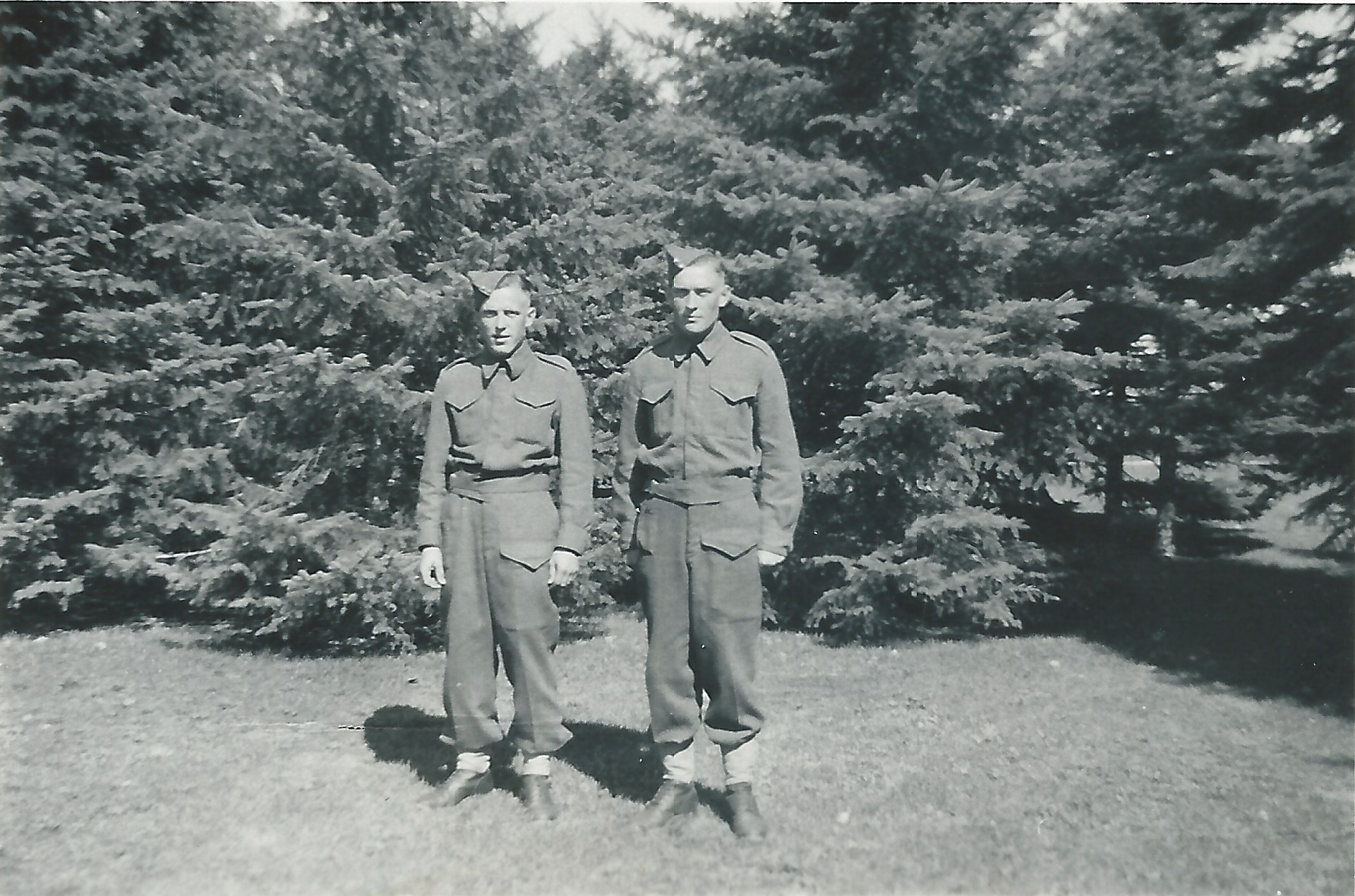 Photo of EARL FREDERICK JONES– Twin brothers Irvin Ray Jones and Earl Frederick Jones. Pictured here while home on leave. The photo was acquired from my Grandmother, Emily Irene Hawkins (Jones) who was their sister.