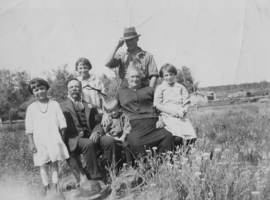 Photo of CLAYTON BYNG MCINTYRE– John and Margaret McIntyre and kids. Clayton front row middle. Submitted for the project, Operation Picture Me