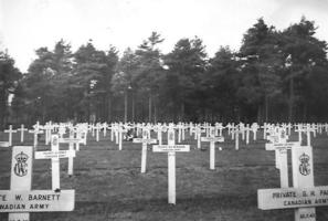 Grave Marker– Photo taken of the grave of B.J. McMahon by Major J. Archie MacNaughton, company commander of A Company of the North Shore Regiment, at the time of the burial of Bob MacLenaghan, November 1942.