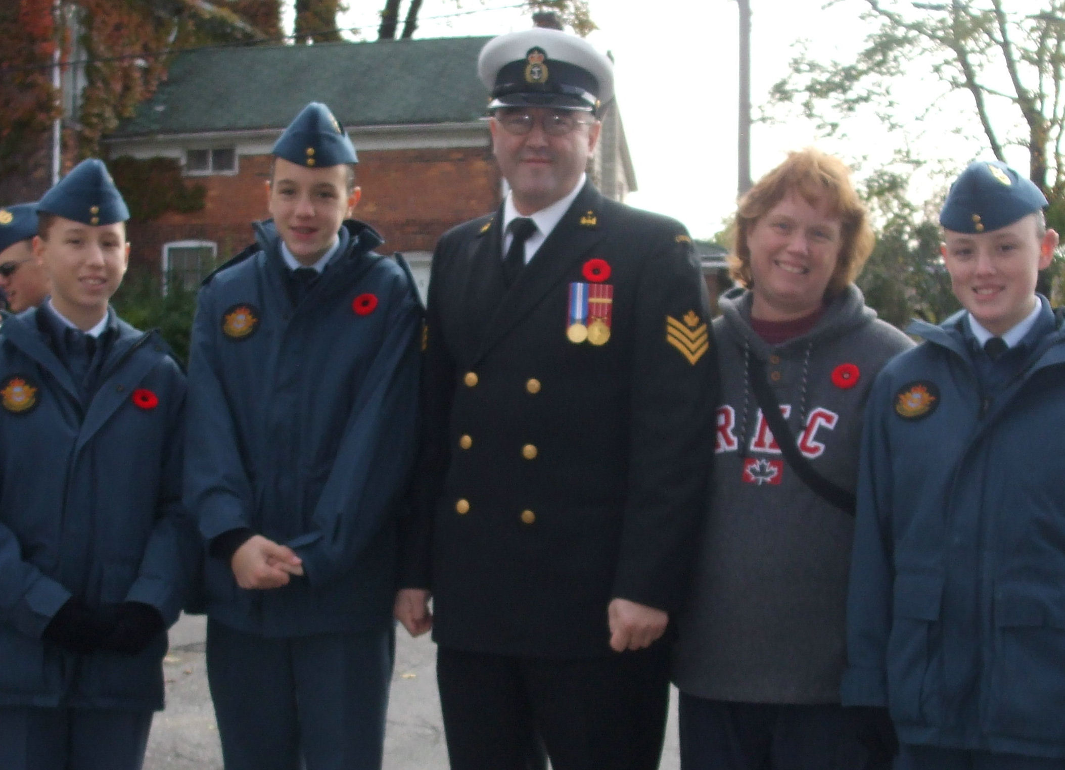 "Group Photo– 11/11/2007 Remembrance Day Ceremony: left to right Air Cadet Flight Corporal Amber Clements (Great Grand-Daughter);  Air Cadet Corporal Erika Clements(Great Grand-Daughter); PO1 Kevin Clements(Royal Canadian Navy / Marine Canadienne Royale); Donna Blais-Clements(Grand-Daughter); and Air Cadet Sargeant Kellie Clements(Great Grand-Daughter).  ""Ready Aye Ready""!"