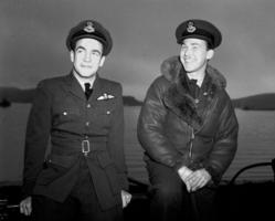 "Group Photo– 6 April 1943 Pilot Officer Frank Grainger, Chilliwack, B.C., second pilot, and Flying Officer W.Y. ""Bill"" Martin, 30 Willcocks St., Toronto, captain and pilot of a Sunderland flying boat 422 RCAF squadron."