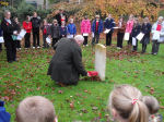 Paying respects– Historian, Tom Champion, lays a wreath at the grave of Fred Sharpe 11.11.2009