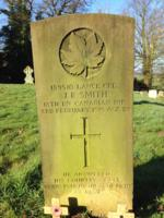 Grave Marker– A lone Canadian warrior resting eternally at the feet of his uncle Henry Cooper's grave   (G) Smith, John Robert (1890-1919) - CWG gravestone (in sunlight) East Stoke