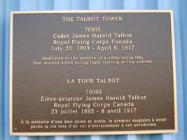 Memorial– This plaque is displayed on the outside of Talbot Tower, the control tower on the airfield at Canadian Forces Base Borden, Ontario.  (Image taken by Gregory J. Barker of Barrie, Ontario, in 2018.)