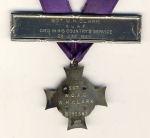 Memorial Cross– Memorial Cross and Birks Bar