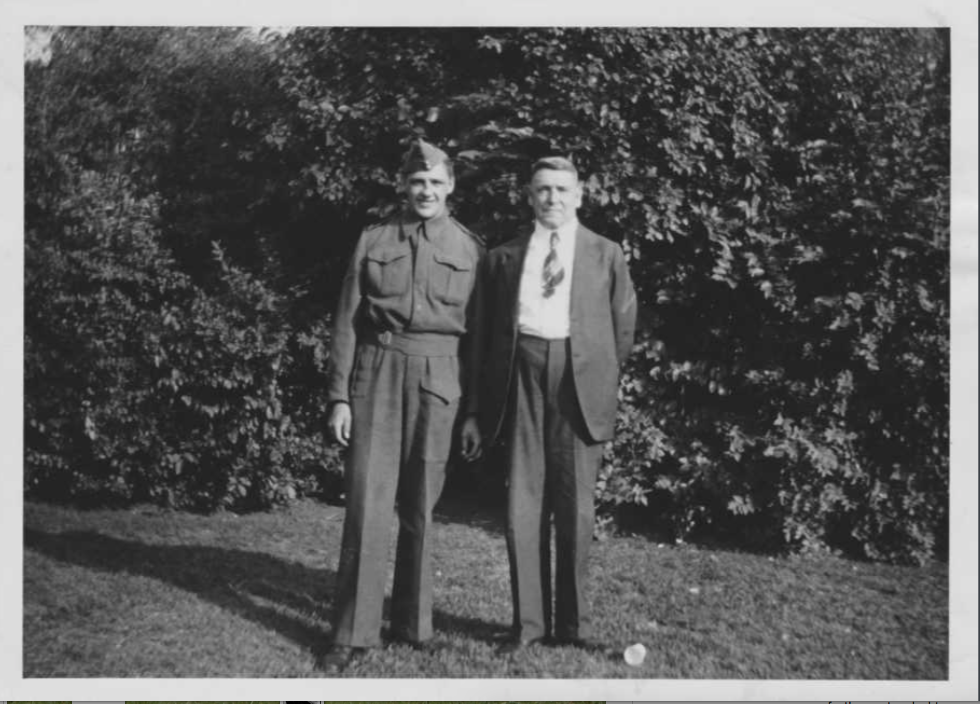 Photo of John and his father.