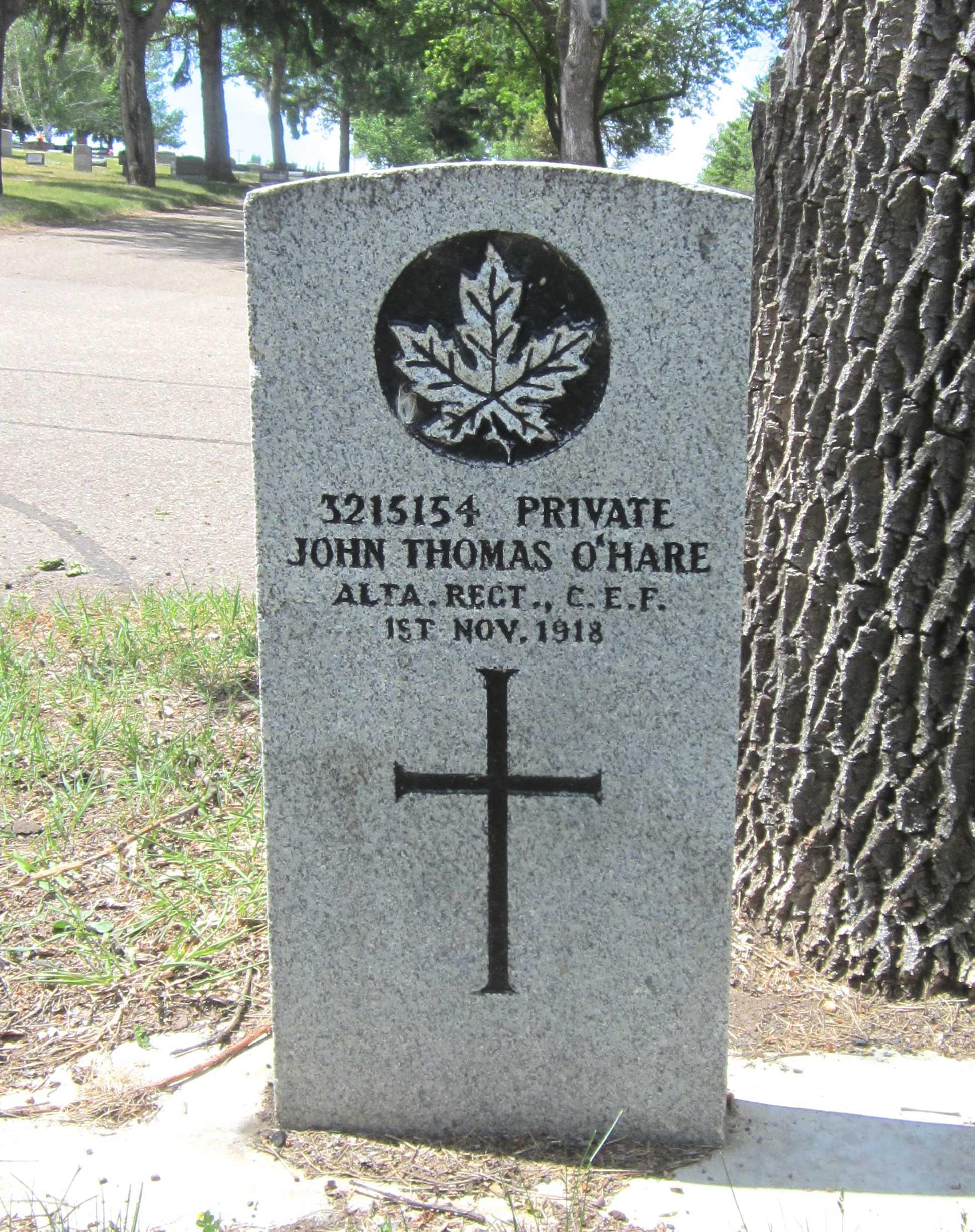 Grave marker– [Maple Leaf] 3215154 PRIVATE JOHN THOMAS O'HARE ALTA. REGT., C.E.F. 1ST NOV. 1918 [Cross]