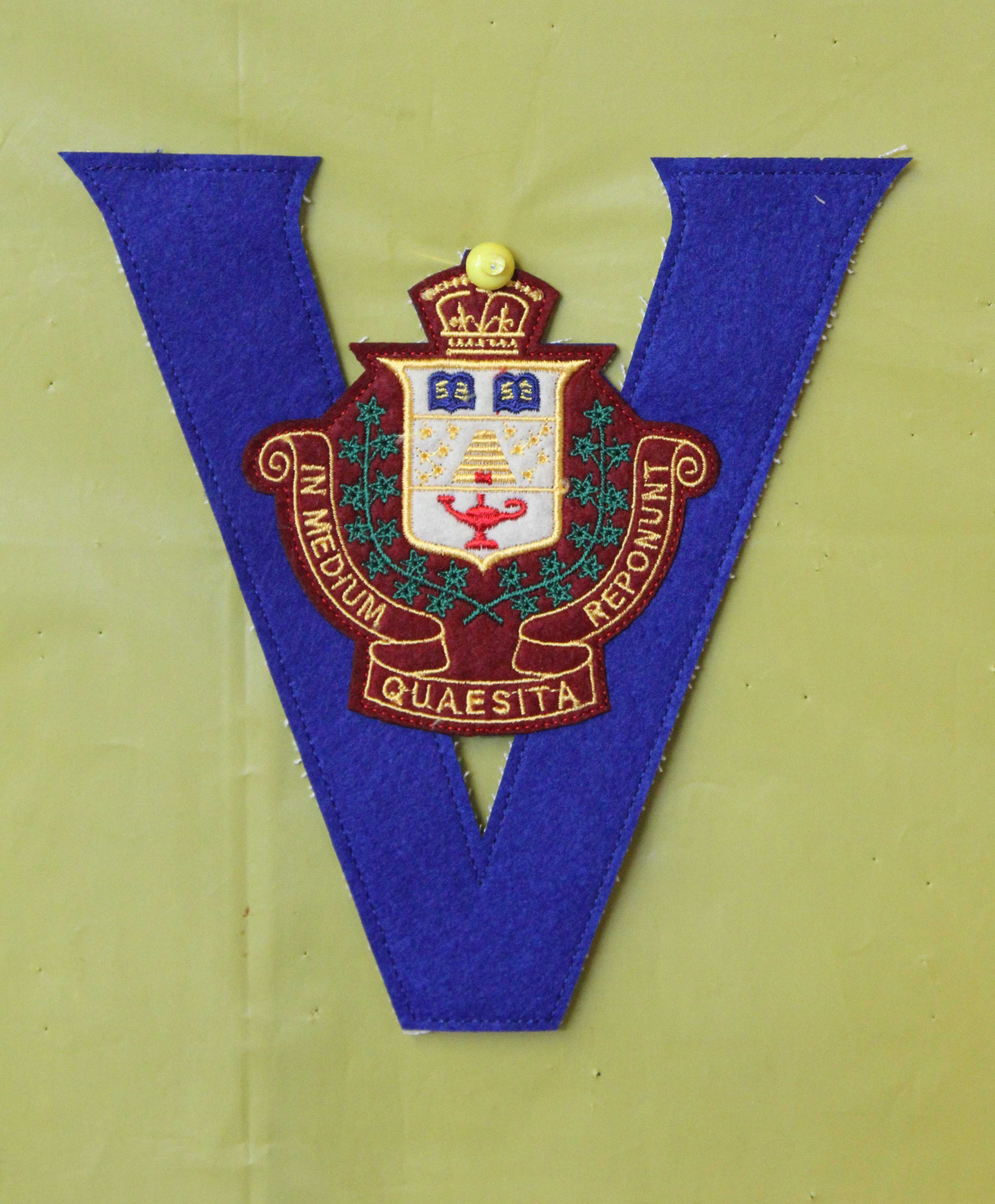 Badge– In memory of the students from the Vaughan Road Collegiate Institute  (Toronto) who went away to war and did not come home. Submitted for the project, Operation Picture Me