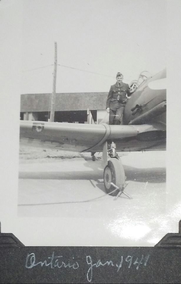 Photo of Archie Ulry– Archie standing of the wing of a Harvard in early 1941